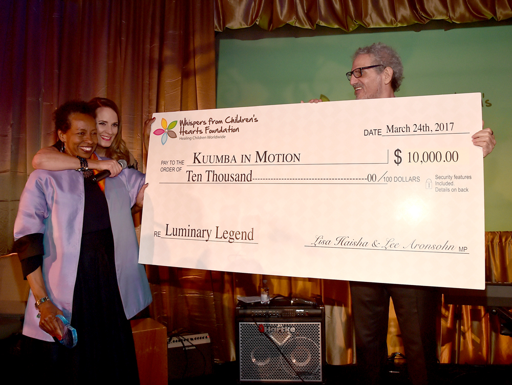 Host Lisa Haisha and writer/producer Lee Aronsohn present honoree Rickie Byars Beckwith with a donation for her charity at the 3rd Annual Legacy Charity Gala at Casa Del Mar on March 24, 2017 in Santa Monica, California. (Photo by Alberto E. Rodriguez/Getty Images)